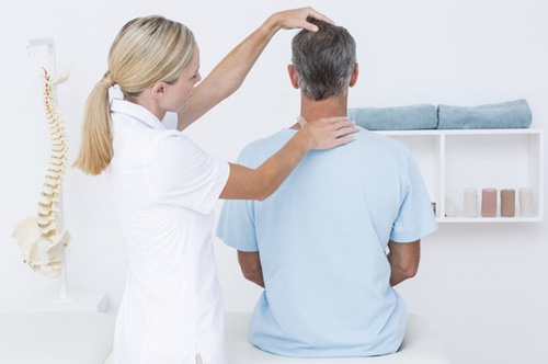 Doctor doing neck adjustment